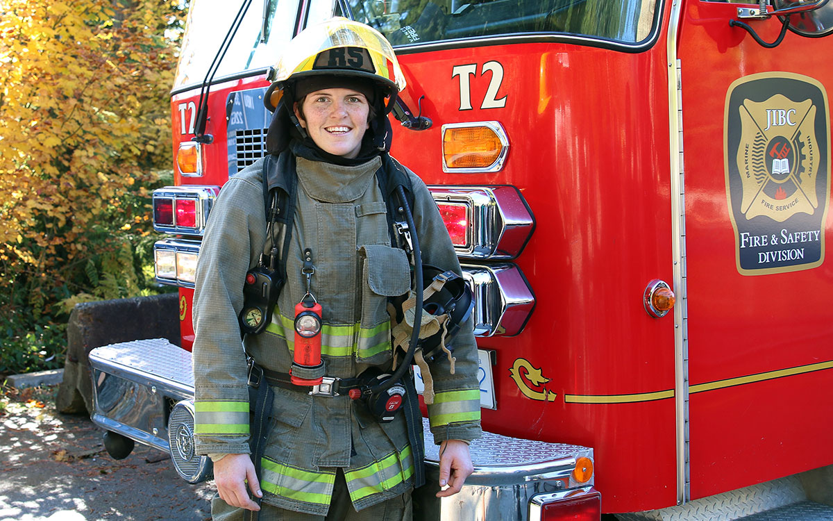 Britt Benn, a member of Canada's 2016 Olympic bronze medal-winning women's rugby team, is all smiles after completing JIBC's Fire Fighting Technologies Certificate program.