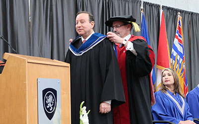 Lorne Segal receives honorary degree from Bob Quartermain
