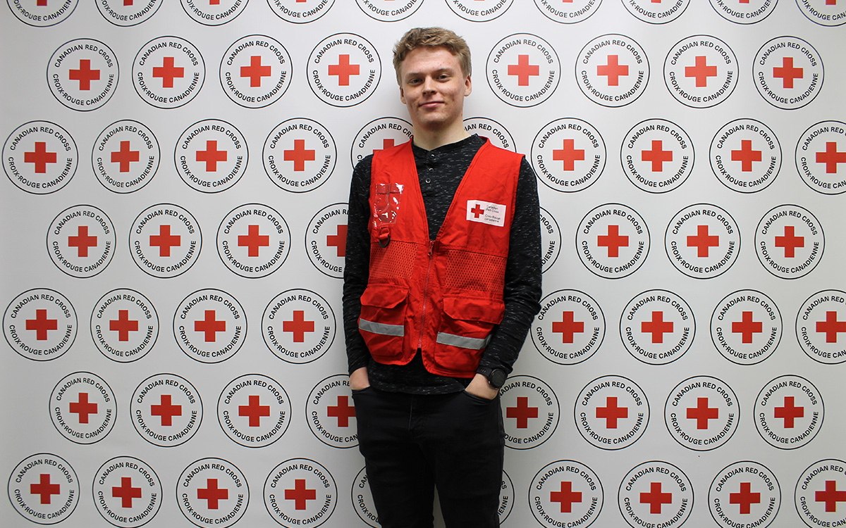 Josh Windsor against Canadian Red Cross backdrop.