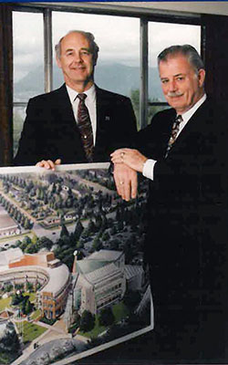 Larry Goble and Bob Stewart with campus rendering