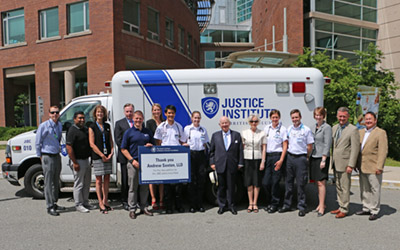 New ambulance unveiled with members of the JIBC Foundation board, JIBC students, and Mr. Saxton