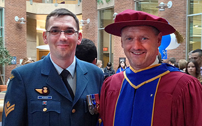 MCpl Charles Wigger at Convocation in February 2014 with JIBC President Dr. Michel Tarko