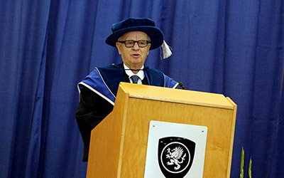 Dr. Andrew Saxton during his acceptance speech at the 2015 Winter Convocation