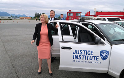 MLAs Lisa Beare and Bob D'Eith, and Michel Tarko after demonstration of first responder driving skills.