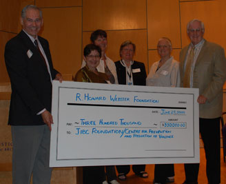 R. Howard Webster Foundation Check presentation