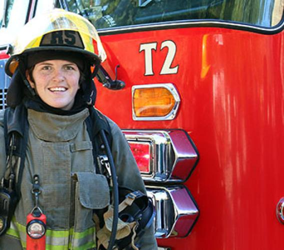 Britt Benn, a member of Canada's 2016 Olympic bronze medal-winning women's rugby team, is all smiles after completing JIBC's Fire Fighting Technologies Certificate program. (Story and photos by Wanda Chow)