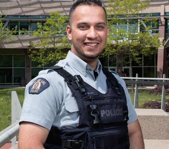 JIBC graduate Mansoor Sahak was hired as an RCMP officer, a role he hopes will help him to give back to Canada for taking in his family as refugees.